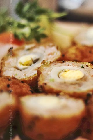 Deep fried prawn balls stuffed with quail eggs.