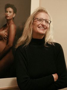 Leibovitz in front of her More Demi Moore Vanity Fair cover photo, 2008. Image from Wikipedia